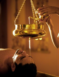 06 Oct 2004, India --- Man receiving Shirodhara treatment at Sereno Spa at Park Hyatt Goa in India. Shirodhara is an Ayurvedic technique of pouring warm oil slowly onto the center of the forehead. | Location: Cansaulim, India. --- Image by © Luca Tettoni/Corbis